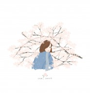 A girl surrounded by cherry blossoms